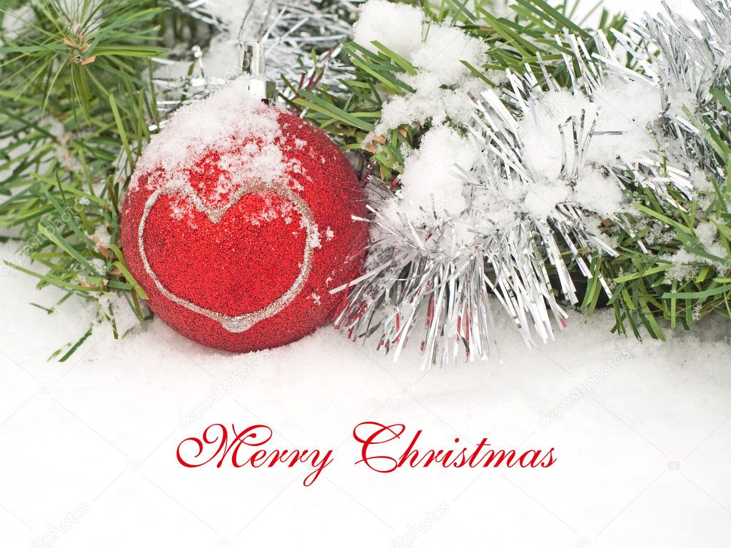 Christmas wreath and red bauble with a heart in snow, with Merry Christmas text — Stock Photo #8973418