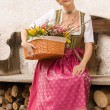 Stock Photo: Young girl with Easter bouquet Bavarian