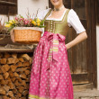 Young girl with Easter bouquet Bavarian — Stock Photo