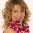 Portrait of woman with orchid — Stock Photo #9679949