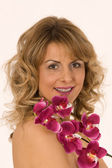 Portrait of woman with orchid — Stock Photo