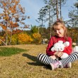 Stock Photo: Little girl with a toy
