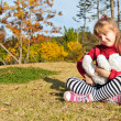 Stock Photo: Little with bear toy