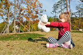 Little girl with white bear toy — Stock Photo