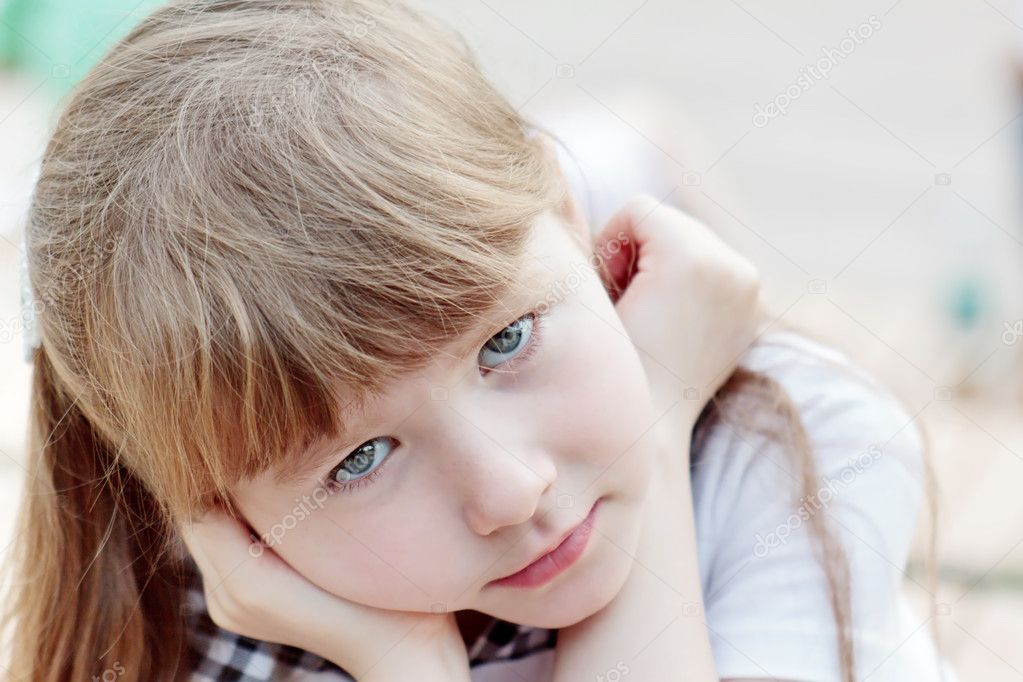 Portrait of a cute girl (7 years old) with gray eyes  Stock Photo #10413384