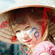Portrait of a little girl with blue dragon on her cheek - Stock Photo