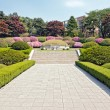 Stock Photo: Manicured garden around the tomb