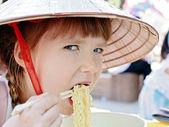 Little girl eating korean style spaghetti (ramen) — Stock Photo