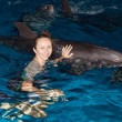 Happy girl and dolphin — Stock Photo #8665543