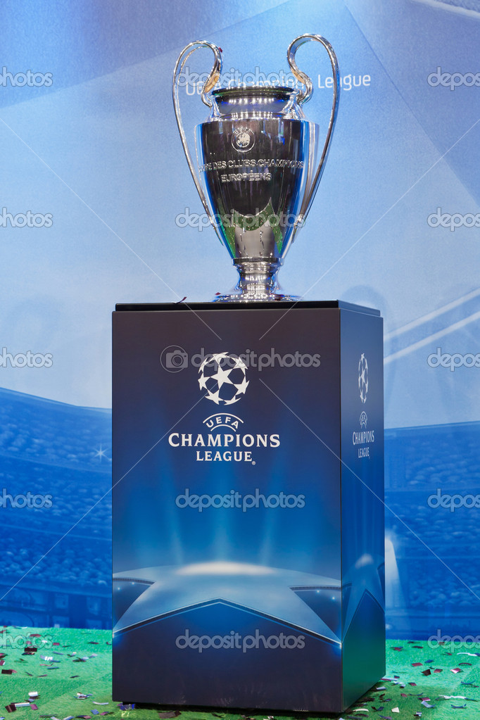 UEFA Champions League trophy on a blue background  Stock Photo #9088275