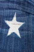 Detail of torn blue denim — Stock Photo