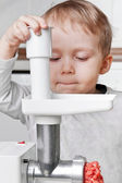 Little boy cutting meat — Stock Photo