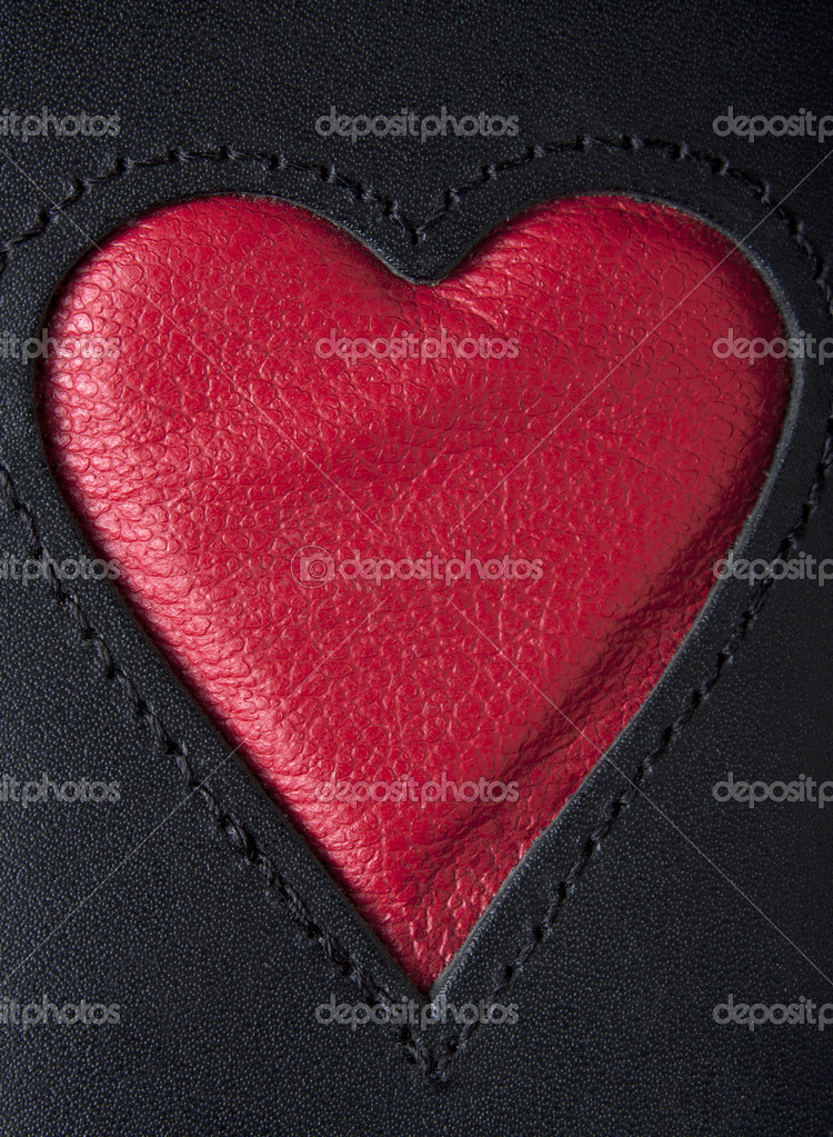Leather heart symbol red on black stiched — Stock Photo #9822776
