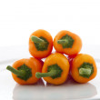 Five Orange Peppers — Stock Photo