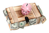 Wooden case with dollar notes and pink piggybank — Stock Photo