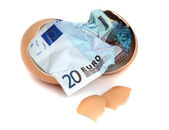 Bank note of 20 euro in eggshell — Stock Photo