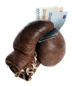 Boxing glove with european banknotes — Stock Photo