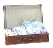 Antiquarian brown suitcase with shirts — Stock Photo