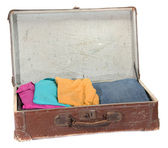 Old suitcase with clothes — Stock Photo