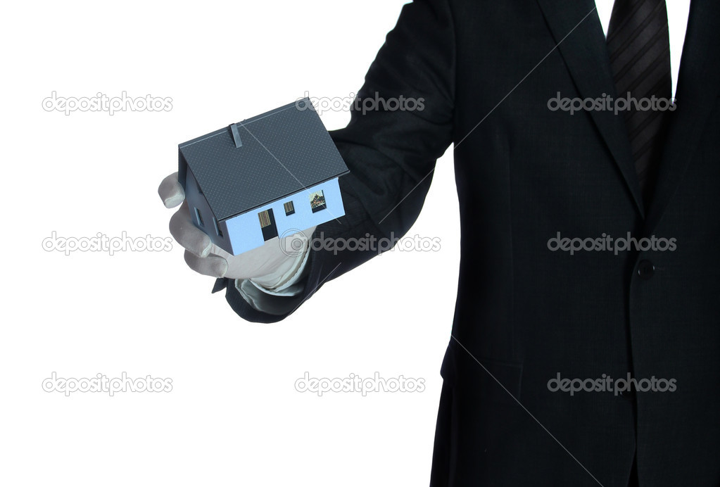 Salesclerk with house in his hand — Stock Photo #9150292