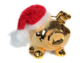 Golden piggy bank with red jelly bag cap — Stock Photo