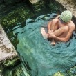 Rustic hotpool. - Stock Photo