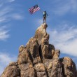 Waving a flag on the summit. — Stock Photo #10644525