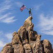 Waving a flag on the summit. — Stock Photo #10644737
