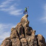 Climber on the summit. — Stock Photo #10644890