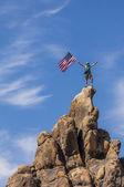 Waving a flag on the summit. — Stock Photo