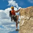 Stock Photo: Rock climber nearing summit.