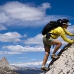Scrambling towards the summit. — Stock Photo