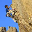Climber charging for the summit. - Foto Stock