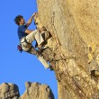 Climber charging for the summit. - Stock Photo