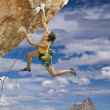 Stock Photo: Rock climber dangling.