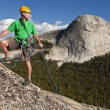 Stock Photo: Climber rappelling from summit.