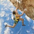 Rock climber dangling. — Stock Photo #9180066