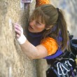 Stock Photo: Female rock climber.