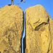 Team of rock climbers. - Stock Photo