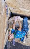 Rock climber struggelling — Stock Photo