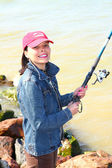 The young woman on fishing — Stock Photo