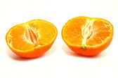 Two halves of a tangerine on white background — Zdjęcie stockowe