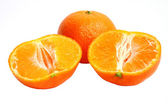 Tangerine with the two halves on a white background — Stockfoto