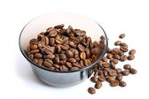 Coffee beans on a dish on a white background — Stock Photo