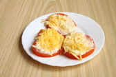 Tomatoes with mayonnaise and cheese — Stock Photo