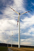 Three wind turbines of the wind farm in a row — Stock Photo