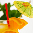 Stock Photo: Refreshing orange drink with straw and umbrella