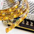 Stock Photo: 3-chip SMD LED strips with power supply
