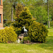 Landscaping with a heron figure - Stock Photo