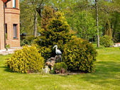 Landscaping with a heron figure — Stock Photo